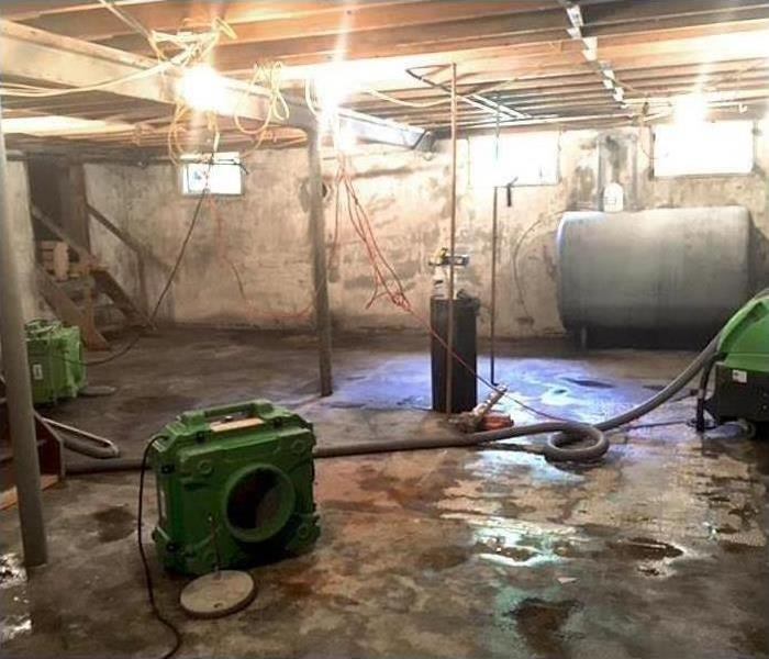 flooded basement in need of water extraction